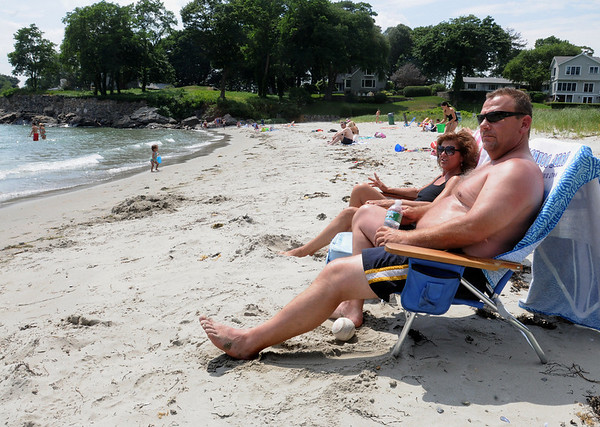 Beverly:<br /> Judy and Steve Knight of Beverly, enjoy the hot summer weather while sitting at Rice's Beach in Beverly on Monday afternoon.<br /> Photo by Ken Yuszkus/Salem News, Monday, June 28, 2010.