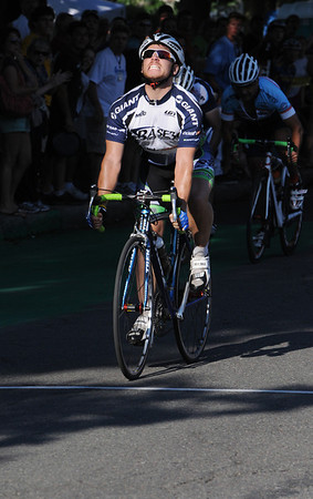 Salem:<br /> Travis Kroot, the winner of the 4/5 Category Mens, grimaces as he is about to cross the finish line during the Witches Cup bicycle races around the common.<br /> Photo by Ken Yuszkus/Salem News, Wednesday, August 10, 2011.