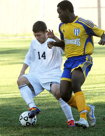 Danvers:<br /> St. John's Prep's Levon Kazelyan, left, keeps the ball under control during the  Acton-Boxboro at St. John's Prep in Division 1 North state tournament boys soccer game.<br /> Photo by Ken Yuszkus/Salem News, Monday, November 7, 2011.
