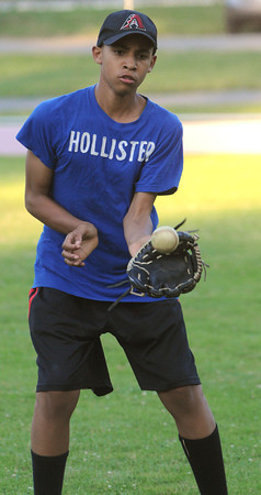 Salem:<br /> Ezekiel Telemaco of the Salem Little League All-Stars catches the ball which was thrown by his teammate during practice at Forest River Park.<br /> Photo by Ken Yuszkus/Salem News, Thursday, June 28,  2012.