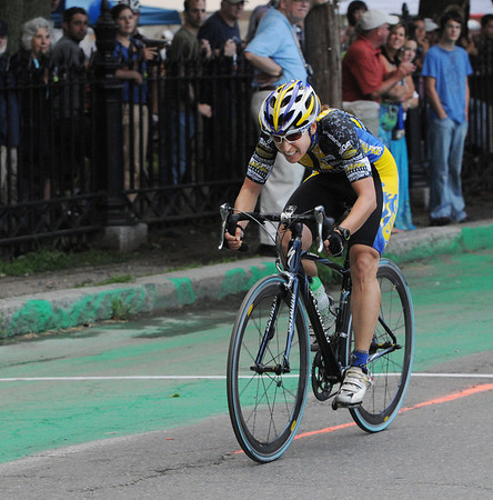 Salem:<br /> Danielle Ruane is the winner of the Elite Womens race as she crosses the finish line during the Witches Cup bicycle races around the common.<br /> Photo by Ken Yuszkus/Salem News, Wednesday, August 10, 2011.
