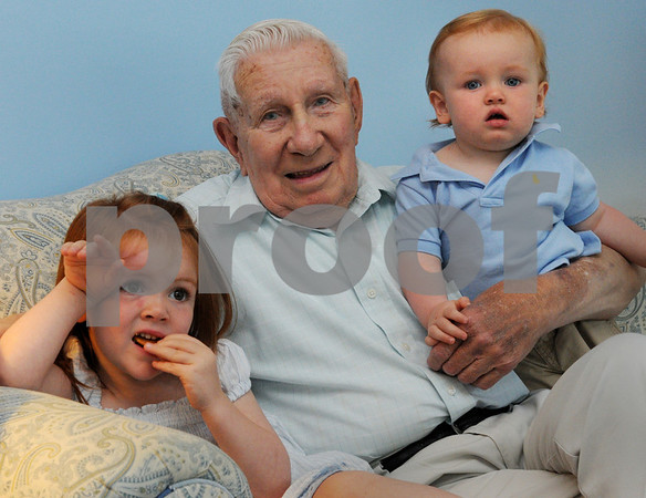 Beverly:<br /> Albert Lilja, and his grandchildren, Lilja Robinson and Henry Robinson, are sitting on the couch at his home. The 85-year-old who quit smoking, is saving the money he would have spent on cigarettes, for his grandchildren.<br /> Photo by Ken Yuszkus/Salem News, Friday, August 7, 2009.