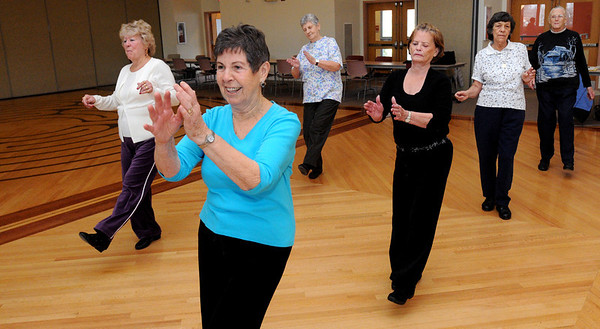 Beverly:<br /> From left, Shirley Kimball, Phyllis Packer, Mary Doody, Ruth Gigliotti, Ellie Bernard, and Lucille Wallace participate in the line dancing program at the Beverly senior center. The group meets Thursday mornings.<br /> Photo by Ken Yuszkus/Salem News, Thursday, January 5, 2012.