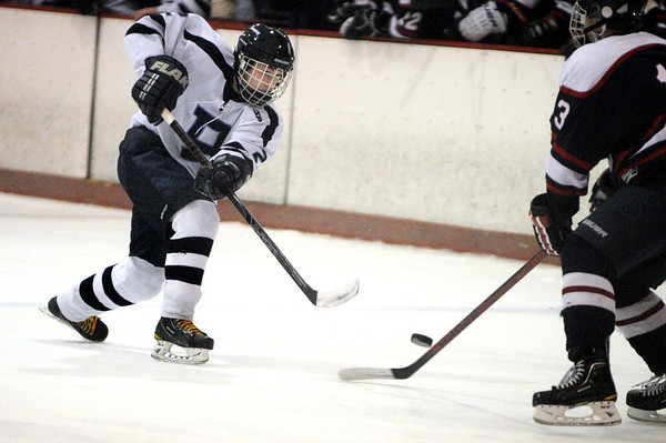 Peabody:<br /> Peabody's Andrew Bisconti, left, moves the puck toward the goal during the Lincoln-Sudbury at Peabody boys hockey game at the McVann-O'Keefe Rink.<br /> Photo by Ken Yuszkus/Salem News, Monday, January 16, 2012.