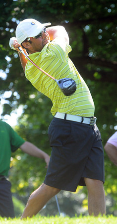 Marblehead;<br /> Josh Salah of Gloucester hits off the 10th tee in the quarterfinals of 104th Mass. Amateur golf championship held at the Tedesco Country Club golf course in Marblehead.<br /> Photo by Ken Yuszkus/Salem News, Thursday, July 12,  2012.