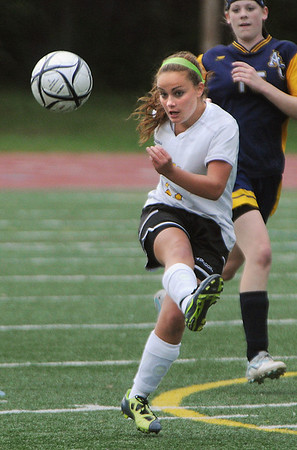 Peabody:<br /> Bishop Fenwick's Vicky Caruso kicks the ball down field during the Arlington Catholic at Bishop Fenwick girls soccer game.<br /> Photo by Ken Yuszkus/Salem News, Monday, October 3, 2011.