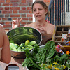 Salem:<br /> Heather Maitland of Salem speaks with a customer at her stand at the Salem Farmers Market.<br /> Photo by Ken Yuszkus/Salem News, Thursday, July 5,  2012.