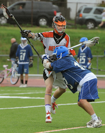 Beverly:<br /> Beverly's Ty Marts, left, is shoved by Danvers' Steven Christopher, during the Danvers at Beverly boys lacrosse game.<br /> Photo by Ken Yuszkus/Salem News, Monday, April 23, 2012.