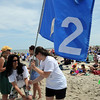Ipswich:<br /> Lina Lopez-Ryan, left, and Heather Chaharyn, both 2nd grade teachers at the Winthrop School, remove their school's flag from the sand at Crane Beach as they prepare to leave with their students after spending most of the day on the beach. Ipswich Public School children have been invited to Crane Beach every spring in a tradition that started with the Crane family, back when then beach was a private estate.  Today is the picnic's 100th anniversary.<br /> Photo by Ken Yuszkus/Salem News, Monday, June 20, 2011.