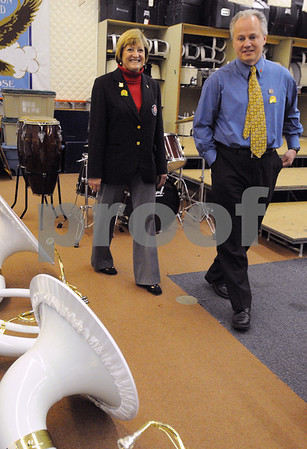 Danvers:<br /> Sally Bixby, left, secretary to the executive committee for the Tournament of Roses, speaks with Ron Parsons while walking in the band room at Danvers High School. The band will perform in the Rose Parade.<br /> Photo by Ken Yuszkus/Salem News, Tuesday May 12, 2009.