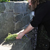 Salem:<br /> Judith Norton of Orlando, Florida lays down a bundle of rosemary at the stone inscribed with George Burroughs' name at the rededication of Salem Witch Trials memorial.<br /> Photo by Ken Yuszkus/The Salem News, Sunday, September 9, 2012.