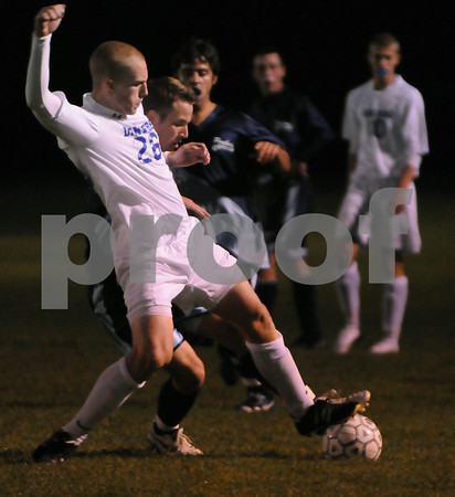 Danvers:<br /> Dylan Davis of Danvers controls the ball as Peabody's Jared Shields, in back, attempts to get the soccer ball at the Peabody vs Danvers boys soccer game at Danvers High School.<br /> Photo by Ken Yuszkus/Salem News, Tuesday September 23, 2008.