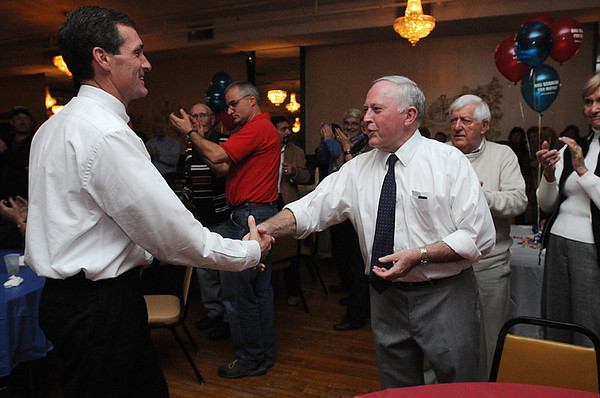 Beverly:<br /> Mike Cahill, left, congratulates Mayor Bill Scanlon, for winning the Beverly mayorial race.<br /> Photo by Ken Yuszkus/Salem News, Tuesday, November 8, 2011.