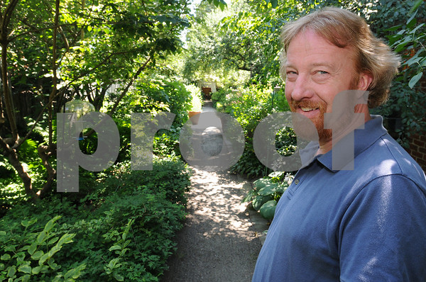 Jonathan Reardon stands in the pathway to his main garden. Jonathan and Jen Reardon's Chestnut Street garden will be featured on the Salem Garden Club's Garden Tour on July 11 and 12.<br /> Photo by Ken Yuszkus/Salem News, Monday, July 6, 2009.