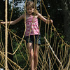 Hamilton:<br /> Rebecca Mallory, 11, crosses the monkey bridge created by Boy Scout Troop 35 of Hamilton at the Hamilton-Wenham 4th of July activities at Patton Park.<br /> Photo by Ken Yuszkus/Salem News, Monday, July 4, 2011.