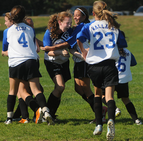 Peabody:<br /> Peabody's Catherine Scacci is congratulated after she scored at the end of the game which tied the score and send the game into overtime in the Peabody vs Lynn U14 game during the Peabody Youth Soccer's annual Columbus Day Tournament at Kennedy School fields.<br /> Photo by Ken Yuszkus/Salem News, Monday, October 10, 2011.