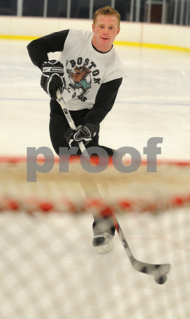 Hamilton:<br /> Tom Smith shoots the puck toward the net at the Pingree hockey rink. He was a former Pingree hockey player, and had a terrible accident while playing junior hockey after getting out of high school.<br /> Photo by Ken Yuszkus/Salem News, Friday, April 3, 2009.