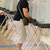 Hamilton:<br /> Susan Zarbo votes in the voting booth at the Winthrop School Thursday afternoon.<br /> Photo by Ken Yuszkus/Salem News, Thursday, May 26, 2011.