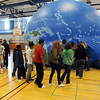 Salem:<br /> A 7th grade class enters the large inflatable globe at the Collins Middle School on Friday afternoon for a presentaion of EarthView, a Bridgewater State College project.<br /> Photo by Ken Yuszkus/Salem News, Friday, October 21, 2011.