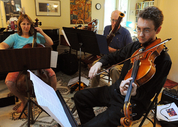 Belmont:<br /> From left, Sarah Freiberg, cello, Neil Fairbairn, bassoon, and Mark Berger, viola, all with Music at Eden's Edge, practice John Wallace's musical tribute to the North Shore while at a home in Belmont.<br /> Photo by Ken Yuszkus/Salem News, Tuesday, June 15, 2010.