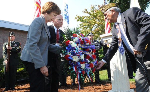 Salem;<br /> From left, Patricia Meservey of Salem State University, Michael Colotti of Osram Sylvania, and Roger Legere of the Salem Veterans Council, lay a wreath near the memorial during the rededication of the WWII memorial located on the grounds of Salem State University.<br /> Photo by Ken Yuszkus/The Salem News, Monday, September 17, 2012.
