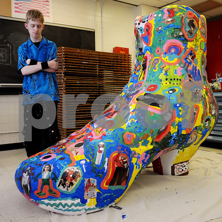 Danvers:<br /> Christopher Worsham, a senior, looks toward the large fiberglass shoe which he helped paint. Many Danvers High School students painted the shoe. It will eventually end up in Haverhill on display with nine others.<br /> Photo by Ken Yuszkus/Salem News, Wednesday May 13, 2009.