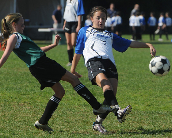 Peabody:<br /> Peabody's Marrisa Tisi, right, kicks the ball during the Peabody vs Lynn U14 game during the Peabody Youth Soccer's annual Columbus Day Tournament at Kennedy School fields.<br /> Photo by Ken Yuszkus/Salem News, Monday, October 10, 2011.