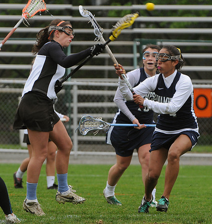 Beverly:<br /> Beverly's Clare Leathersich, left, shoots and scores despite, Swampscott's Gabby Wooten try to block the shot during the Swampscott at Beverly girls lacrosse game at Hurd Stadium.<br /> Photo by Ken Yuszkus/Salem News, Monday, May 16, 2011.