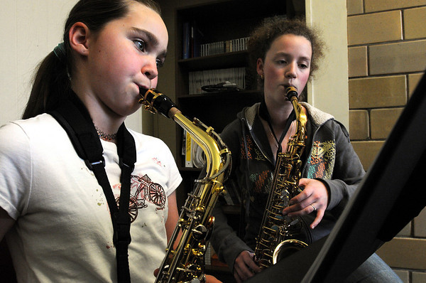 Beverly:<br /> Autumn Becker, left, 6th grader at Briscoe Middle School, receives help mastering her alto sax from Sarah Bowen, a junior at Beverly High School.<br /> Photo by Ken Yuszkus/Salem News, Tuesday November 10, 2009.