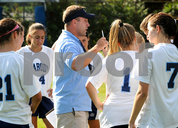 Peabody:<br /> Peabody's girls soccer coach, Dennis Desroches, speaks to the team before their game with Lynn English at Peabody at Peabody High School on Tuesday.<br /> Photo by Ken Yuszkus/Salem News, Tuesday, September 15, 2009.