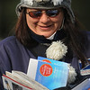 Beverly:<br /> Pam McMasters, letter carrier, wearing her siberian husky hat, is bundled up against the cold Friday morning while delivering letters in Beverly. <br /> Photo by Ken Yuszkus/Salem News, Friday,  December 10, 2010.