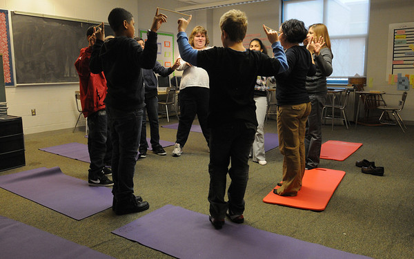 Salem:<br /> Performing yoga at the Collins Middle School are students in Sarah Mason's Learning Skills Classroom.<br /> Photo by Ken Yuszkus/Salem,  News, Monday,  December 20, 2010.