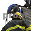 Beverly:<br /> Roberto Yapor crawled off the peek of the roof of the United Methodist Church onto the firetruck's ladder. Many onlookers watched as police and fire personel attempted to get him down. Beverly fire captain Peter O'Connor grabs the Roberto Yapor as Danvers firefighters Craig Vesey and David Mondi climb the ladder to also get him down safely.<br /> Photo by Ken Yuszkus/Salem News, Monday October 6, 2008.