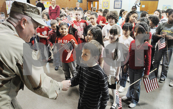 Peabody:<br /> Dan Barrasso, navy petty officer 1st class, greets  the first and third grades after the assembly at the McCarthy Memorial School for his presentation of a flag that flew over Iraq to the school. Dan just returned from Iraq.<br /> Photo by Ken Yuszkus/Salem News, Thursday April 4, 2009.
