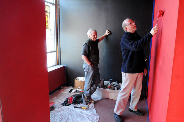 Salem:<br /> John Fogle, left, and Gary LaParl work in the foyer of the Salem Theatre Company.<br /> Photo by Ken Yuszkus/Salem News, Monday, February 1, 2010.