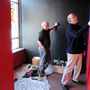 Salem:<br /> John Fogle, left, and Gary LaParl work in the foyer of the Salem Theatre Company.<br /> Photo by Ken Yuszkus/Salem News, Monday, February 1, 2010.