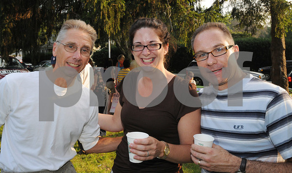 Beverly:<br /> Fom left, Chris Sadkowski, Colleen Michaels and her husband, Chris Michaels, at the Rep. Mary Grant Annual Homecoming Ice Cream Social at the Church in the Cove which is a fundraiser for  Beverly Homecoming.<br /> Photo by Ken Yuszkus/Salem News, Monday, August 3, 2009.