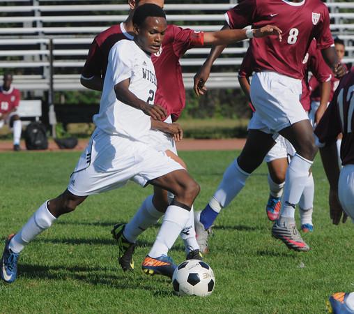 Salem:<br /> Salem's Abdi Mwanambaji powers the ball toward the net at the Lynn English at Salem boys soccer game.<br /> Photo by Ken Yuszkus/The Salem News, Thursday, September 13, 2012.