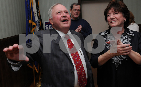 Beverly:<br /> Mayor William Scanlon and his wife Louise react to the incoming tallies from the various polling places.<br /> Photo by Ken Yuszkus/Salem News, Tuesday November 3, 2009.