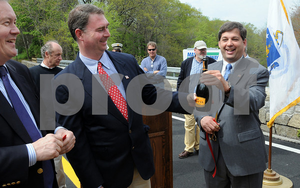 Hamilton:<br /> From left, Bob Markel, Ipswich town manager, Representative Brad Hill, and Senator Bruce Tarr, look over a bottle of champagne that appeared during the ceremony to reopen the Highland Street/Mill Road bridge. The bridge was closed for three years.<br /> Photo by Ken Yuszkus/Salem News, Friday May 8, 2009.