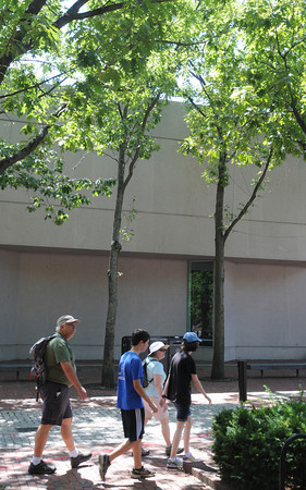 Salem:<br /> Pedestrians walk by the trees in front of the Peabody Essex Musem. The museum plans to cut down several trees in front of the Dodge Building as part of its $200 million addition.<br /> Photo by Ken Yuszkus/The Salem News, Monday, August 13, 2012.