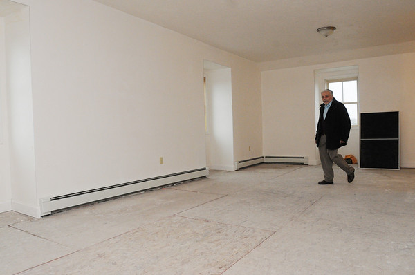 Peabody:<br /> Don Preston  is in the familyroom of one of the two new units built by Habitat for Humanity at 5 Park Street .<br /> Photo by Ken Yuszkus/Salem News, Monday, April 4, 2011.