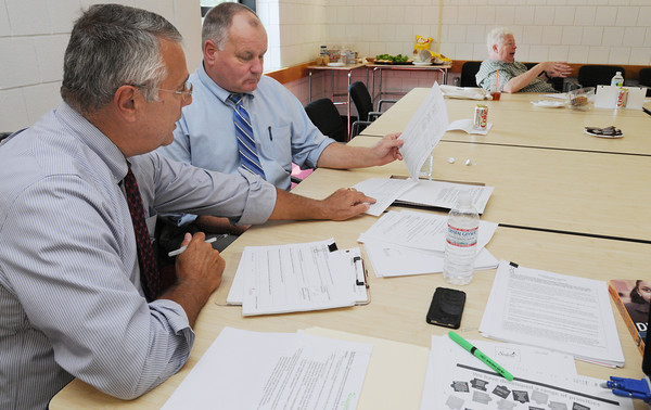 """Salem:<br /> Dr. John Brackett, left, works with Dr. Stephen Russell, Salem Superintendent of schools, at Salem High School. Dr. John Brackett has been sent to Salem by the state department of education to work as a """"plan manager"""" for the districts improvement plan. <br /> Photo by Ken Yuszkus/The Salem News, Friday, September 7, 2012."""