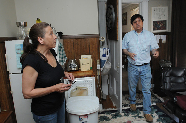 Beverly:<br /> Lynn Pellino, left, executive director, and Victor Capozzi, tresurer, with North Shore Veterans Counseling Services, Inc., in one of the apartments at the veterans home at the corner of Park Street and Railroad Avenue in Beverly.<br /> Photo by Ken Yuszkus/Salem News, Tuesday, June 28, 2011.