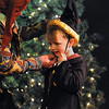 Salem:<br /> Jay Menice, left, as professor Wiggledom, places a wizard hat on audience member, Quinn Hitchcock of Swampscott, on stage during The Harry Potter Wizards Show at The Griffin Theatre on Sunday.<br /> Photo by Ken Yuszkus/Salem,  News, Sunday,  December 26, 2010.