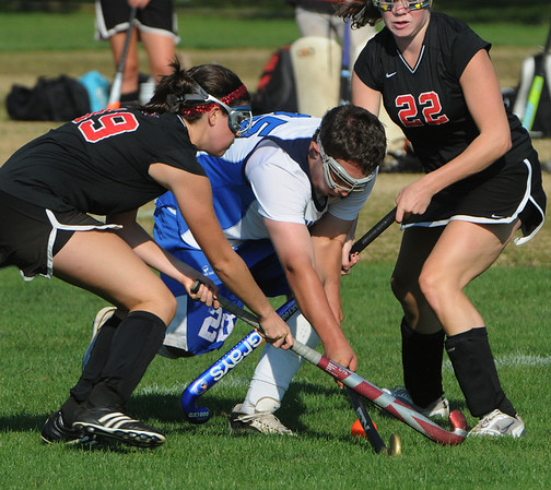 Danvers:<br /> From left, Marblehead's Ellie Rousseau, Danvers' Seth Kamens, and Marblehead's Tyler Phillips fight for the ball at the Marblehead at Danvers High School field hockey game.<br /> Photo by Ken Yuszkus/Salem News, Monday, September 12, 2011.
