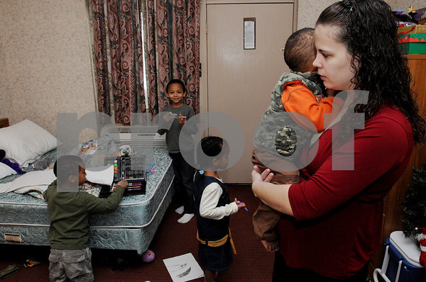Danvers:<br /> Kamika Bangura with her children at the Days Inn where they are staying. She is holding Jared, 1 1/2, and from left is William, 6, Mohamed, 8, and Leona, 4. <br /> Photo by Ken Yuszkus/Salem News, Wednesday December 24, 2008.