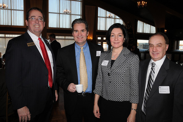 Danvers:<br /> From left, Bill Hudak running for U.S. Congress, Michael Harrington of Beverly, with The Entrepreneur's Source, Patricia Beckwith of Danvers, with Constitution Financial Partners, and Al Dichner of Middleton, with R & L Asssociates, Inc. chat before breakfast at The North Shore Chamber of Commerce event held at the Danversport Yatch Club.<br /> Photo by Ken Yuszkus/Salem News, Wednesday, January 6, 2010.