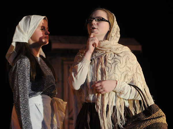"""Danvers:<br /> Madelyn Dunn, left, plays Golda and Miranda Funari plays Yente, the matchmaker, during the rehearsal for the musical, """"Fiddler on the Roof Jr."""" which will be playing at the Holten-Richmond Middle School Friday, February 10th, at 7:00 pm, and Saturday February 11th, at 1:00pm and 7:00 pm. Limited tickets will be available at the door.<br /> Photo by Ken Yuszkus/Salem News, Monday, February 6, 2012."""