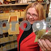 Salem:<br /> Rosemary Draper manages the National Park Service's West India Goods Store. She is holding Rosemary, which is one of the spices the store sells.<br /> Photo by Ken Yuszkus/Salem News, Thursday December 4, 2008.